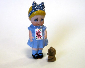 "Doll 4"" miniature girl with bow cast in porcelain  from a vintage mold wearing a blue dress"