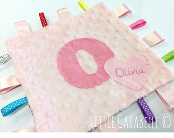 Handmade personalised Initial baby comforter blanket in plush/minky dimples with rainbow tags and embroidered name heart