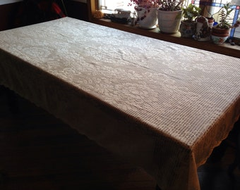 Vintage off-white lace table cloth.