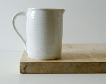 Tall bellied pouring jug - wheel thrown and glazed in brilliant white