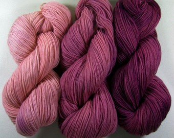 3 skeins of cochineal-dyed SW Corriedale/Nylon yarn, natural dyes