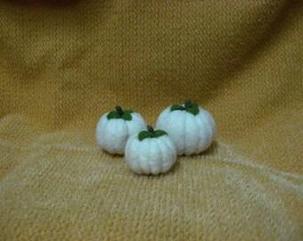 Three White Pumpkins