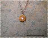 repurposed 45 winchester automatic bullet,  jewelry, pendant, swarovski crystal,brass, silver beaded setting,