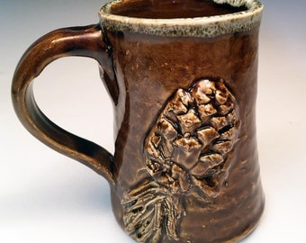 Rustic Stoneware Pine Cone Mug in Warm Amber Brown with drip glaze