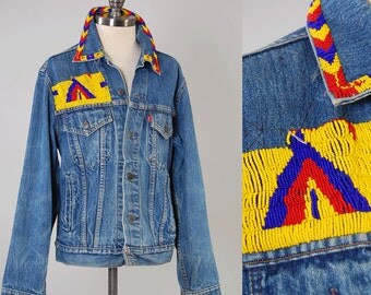Vintage LEVIS denim trucker jacket with southwestern beaded design / Perfectly faded distressed denim / size 40 jacket