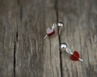 Tiny red hearts - sterling silver ear studs