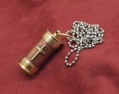 Cremation ashes necklace, copper and brass