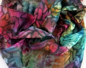Multi colored hand dyed cut silk scarf doubles as shawl