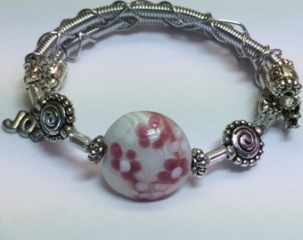 Memory Wire Bracelet with Pink Bead and Charms