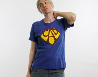 Vintage 70's t-shirt, blue cotton Sportswear brand, Superman style logo, letters C-A-D, soft, nicely worn in - Medium