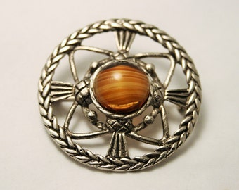 Vintage Scottish thistle brooch. Brown stone
