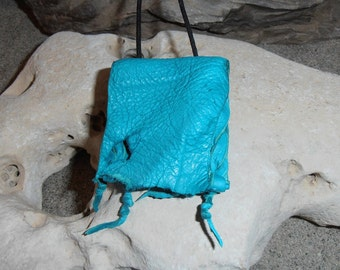 Mermaid...This Wisdom Pouch is made out of Turquoise colored Deerskin leather with a shimmery Turquoise Fish hide leather accent.