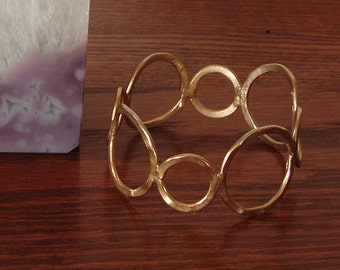 Vintage Gold Tone Wide Circle Cuff Bracelet from Wood Stock era
