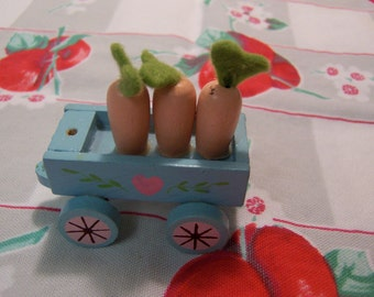 lil wooden cart with carrots