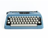 "1967 Brother - Kmart Deluxe 100 Compact Portable Typewriter ""Snappy Blue"""