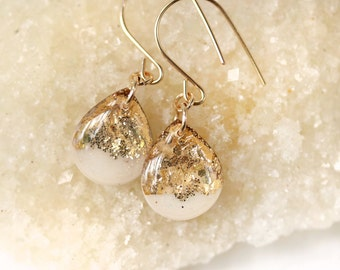 white and gold leaf and glitter teardrop earrings on 14 karat gold fill ear wires