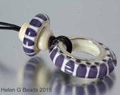 Purple lampwork necklace. Handmade by Helen Gorick