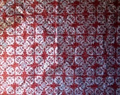 Large sheet red tissue paper, handprinted in silver with tribal design linoprint