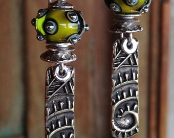 Artisan earring #25...Wayne Robbins glass beads and Judie Mountain bronze charms