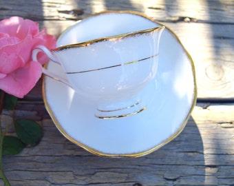 White and gold teacup and saucer Royal Albert England bone china vintage wedding anniversary