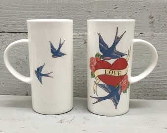 Tattoo inspired love mug featuring swallows, roses and hearts.