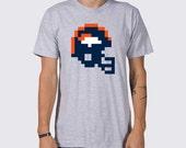 Denver Broncos 8-Bit Tecmo Bowl Helmet T-Shirt ( Denver Broncos Shirt, Tecmo Helmet Shirt, Peyton Manning Football Shirt, CJ Anderson )