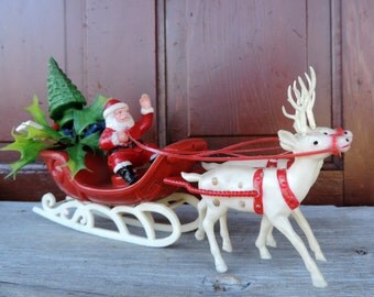 Vintage Santa Claus Reindeer Sled Decoration 1960's Christmas Holiday Decor Plastic Christmas Tree with Holly Toys in Sled Jolly and Cute
