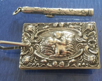 Fan Shaped Miniature Dance Card / Aide Memoire/ with Cherubs/ Sterling Silver with Silver Pencil...1904