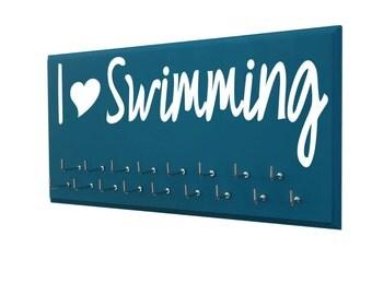 Swimming: Use a awards display rack to display your swimming awards - I love swimming logo for teen girl