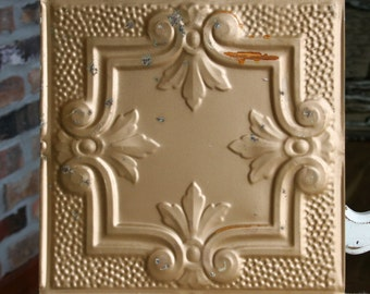 "12"" Antique Tin Ceiling Tile -- Rusty Gold Colored Paint -- Pretty Framed Design with Fleur De Lis"