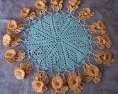Vintage hand crochet dimensional round sage green doily with orange cup flowers.   C2-355-2