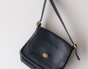 Navy blue Coach Rambler Legacy purse