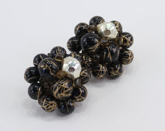 SALE 20 PERCENT OFF Vintage Signed Japan Black Metallic Goldtone Splattered Gold Tone Plastic Faceted Beaded Cluster Clip On Earrings