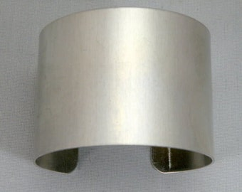 1 3/4 inches wide by six inches long, one dozen (12) Aluminum Cuff Bracelet Blanks