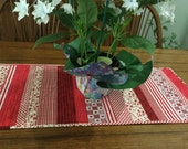 Multi reds, reversible tablerunner