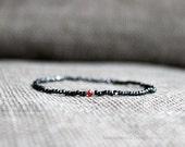 Ruby metal mens small bead bracelet - mens bracelet dark metallic gray with ruby gem center - MariaHelenaDesign