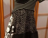 White and Black and Funky! Size small to medium