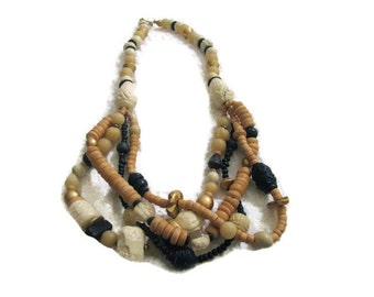 All natural bib necklace. Wood, metal, clay and glass textured beads in natural tones. GREAT bohemian necklace