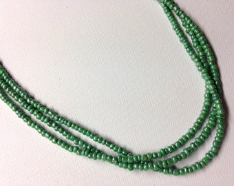 Green Seed Bead Necklace With Ornamental Silver Cone
