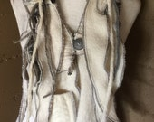 Scarf vest on boiled wool with embellishment and rag style collar. Winter white