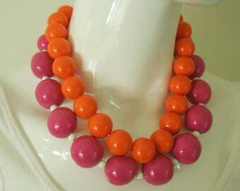 2 Mod 1970s Plastic and Wood Huge Beaded Necklaces Fuschia Pink Orange
