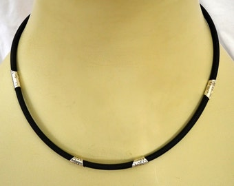 4mm Black rubber cord with sterling silver ferrules and clasp.  18 inch