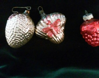 Three mercury glass ornaments, berries and butterfly