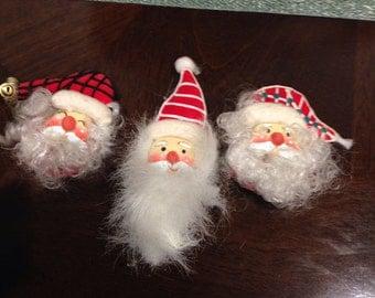 trio of santa head magnets