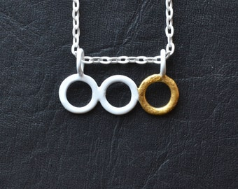 small white three ring pendant with gold leaf detail on white chain, simple circle necklace powdercoated matte white with handmade clasp