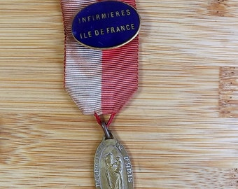 French nurse's medal - Notre Dame de Paris, along  with nurse's enamel badge from Paris
