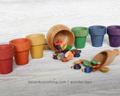 The Jar of bugs.  Scoop, sort and count wooden toy set.