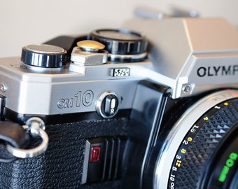 Classic Working Olympus OM 10, with manual Adapter and Zuiko f1.8 50mm standard lens