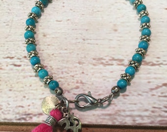 Beaded Turquoise and Silver Bracelet with tassel and sterling silver Ohm charm