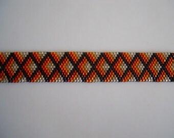 Beaded Silver, Orange and Black bracelet